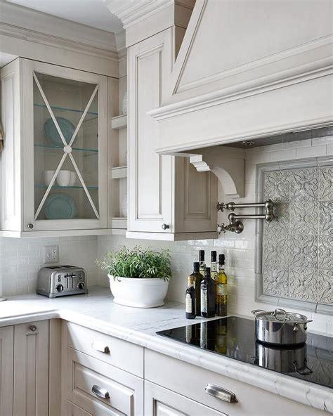 grey kitchen cabinets with backsplash gray mosaic cooktop backsplash traditional kitchen
