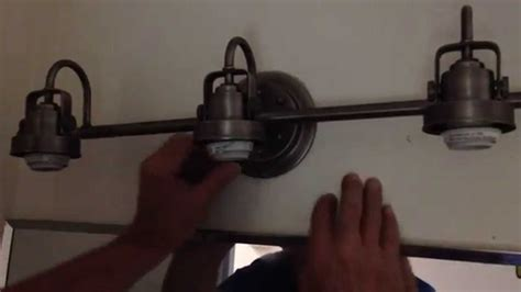 how to install a light fixture how to install a bathroom light fixture part 2