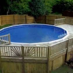traditional backyard design with above ground pool deck and wooden deck floor pool blue world