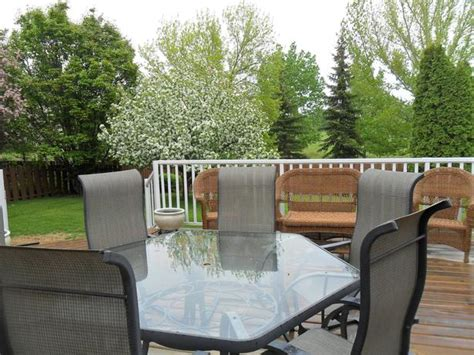 glass patio hexagon table and six chairs east