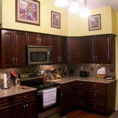 darkening kitchen cabinets orange kitchens with cherry cabinets and stainless steel 3102