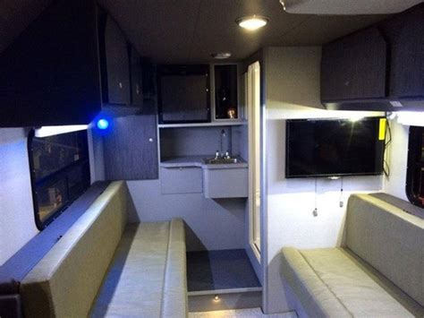 man designs builds produces grid micro cabin trailer