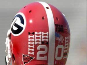 collegiate - Why are there stickers on helmets of football ...