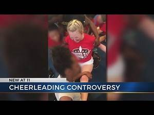 Local cheerleaders react to video showing girls forced into splits
