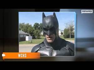 Two men dressed as superheroes rescue cat from building