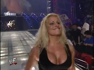 Trish Stratus Puts Lita Through A Table! (Then Taunts Her!)
