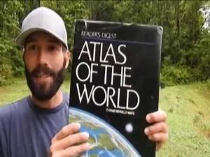 """A Flat Earth Map Appears in the """"Atlas of the World"""""""