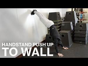 HANDSTAND PUSH UP TO THE WALL