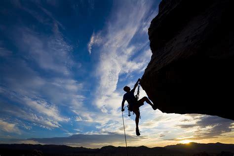 Man Climbing Mountain Silhouette